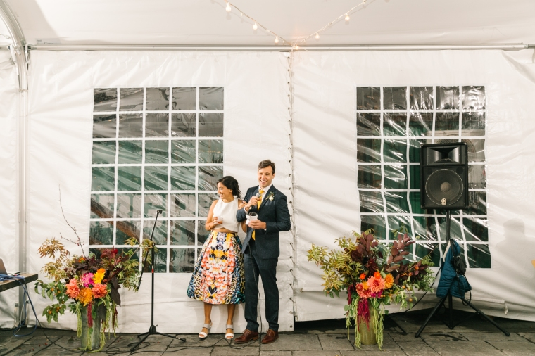Couple and Large arrs local flowers brooklyn wedding